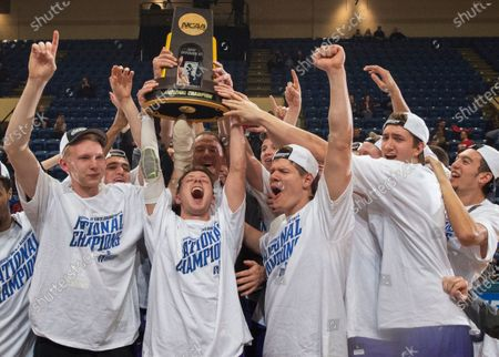 Stock Picture of St. Thomas players, from left, Thomas Sjoberg, Grant Shaeffer, Will Dunn, Jodan Burich and G.T. Johnson celebrate after St. Thomas won NCAA Division III men's college basketball championship game 82-76 over Benedictine in Salem, Va. The NCAA has given the University of St. Thomas permission to move its sports teams directly from Division III to Division I. The Tommies were granted a waiver to bypass the current reclassification rules that require a stop first in Division II