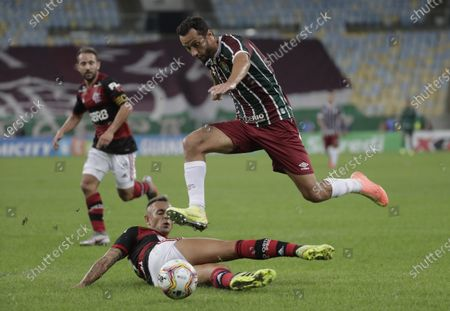 Rafinha (below) of Flamengo in action against Nene (above) of Fluminense during the Carioca Championship second leg final match between Flamengo and Fluminenes at Maracana stadium in Rio de Janeiro, Brazil, 15 July 2020.