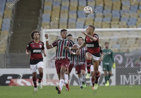 Rafinha (R) of Flamengo in action against Marcos Paulo (C) of Fluminense during the Carioca Championship second leg final match between Flamengo and Fluminenes at Maracana stadium in Rio de Janeiro, Brazil, 15 July 2020.