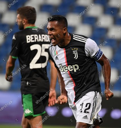 Juventus' Alex Sandro (R) celebrates after scoring during a Serie A football match between Sassuolo and Juventus in Reggio Emilia, Italy, July 15, 2020.