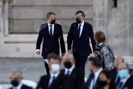 Stock Photo of Former Spanish Prime Minister Jose Luis Rodriguez Zapatero (L) and Mariano Rajoy (C) arrive at the parade ground of the Royal Palace to attend the state tribute to coronavirus disease (COVID-19) victims and people working on the front line to fight against pandemic in Madrid, Spain, 16 July 2020. The ceremony is to be chaired by Spain's King Felipe VI.