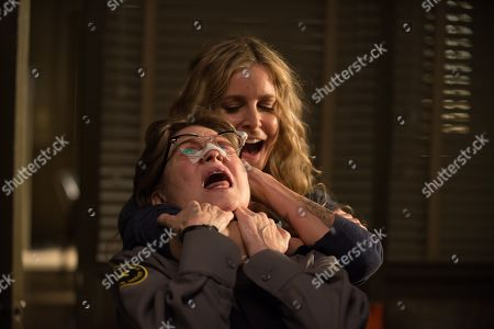 Stock Image of Dee Wallace as Greta and Sheri Moon Zombie as Baby