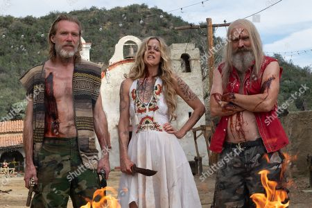 Stock Picture of Richard Brake as Winslow Foxworth Coltrane, Sheri Moon Zombie as Baby and Bill Moseley as Otis Driftwood