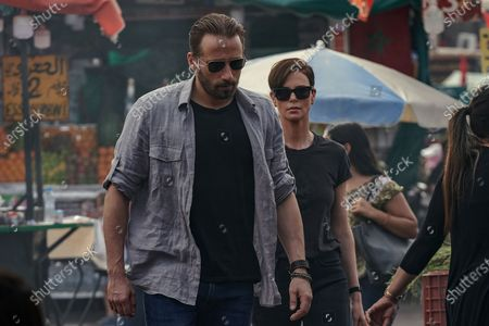 Matthias Schoenaerts as Booker and Charlize Theron as Andy