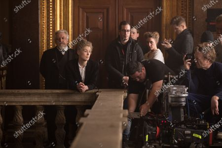 Simon Russell Beale as Professor Lippmann and Rosamund Pike as Marie Curie