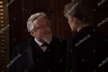Stock Image of Simon Russell Beale as Professor Lippmann and Rosamund Pike as Marie Curie