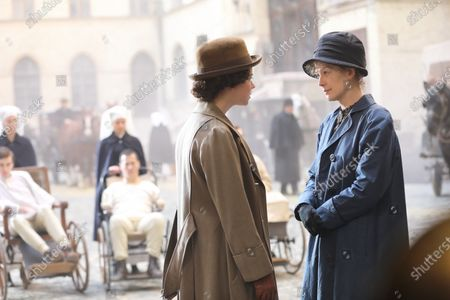 Anya Taylor-Joy as Irene Aged 18 and Rosamund Pike as Marie Curie