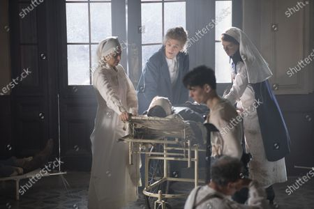 Mirjam Novak as Nurse, Rosamund Pike as Marie Curie and Anya Taylor-Joy as Irene Aged 18