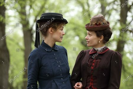 Stock Photo of Rosamund Pike as Marie Curie and Sian Brooke as Bronia Sklodowska