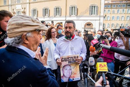Stock Picture of Leader of Lega party Matteo Salvini (R) and Italian actor Enrico Montesano meet the demonstrators during the sit-in in front of Montecitorio Palace to ask for justice for Chico Forti