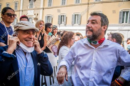 Stock Image of Italian actor Enrico Montesano (L) and leader of Lega party Matteo Salvini meet the demonstrators during the sit-in in front of Montecitorio Palace to ask for justice for Chico Forti