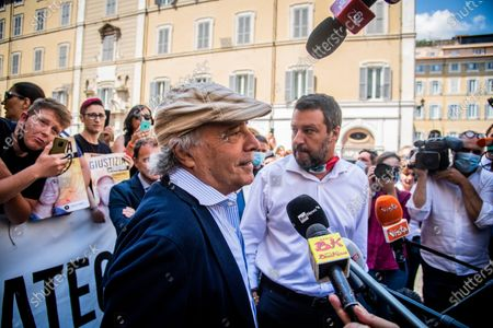 Leader of Lega party Matteo Salvini (R) and Italian actor Enrico Montesano meet the demonstrators during the sit-in in front of Montecitorio Palace to ask for justice for Chico Forti