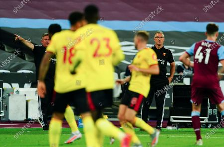 Watford Manager Nigel Pearson looks on alongside his assistant Craig Shakespeare - both men were subsequently sacked by the club with just two Premier League matches remaining in the season
