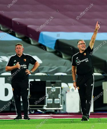 Stock Image of Watford Manager Nigel Pearson looks on alongside his assistant Craig Shakespeare - both men were subsequently sacked by the club with just two Premier League matches remaining in the season