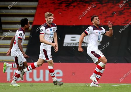 Che Adams (right) celebrates scoring the 2nd Southampton goal with Kyle Walker-Peters and Stuart Armstrong