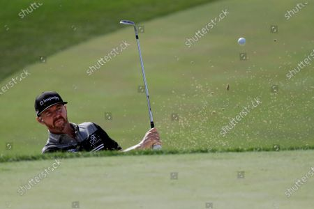 Jimmy Walker hits to the 18th green during the first round of the Memorial golf tournament, in Dublin, Ohio