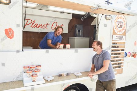 Dax Shepard mans the Planet Oat food truck and serves his favorite Planet Oat Non-Dairy Frozen Dessert flavor, Chocolate Peanut Butter Swirl, to bestie Ryan Hansen on in Los Angeles