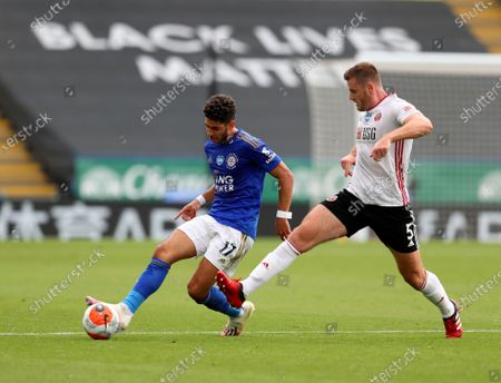 Leicester's Ayoze Perez, left, duels for the ball with Sheffield United's Jack O'Connell during the English Premier League soccer match between Leicester City and Sheffield United at the King Power Stadium, in Leicester, England