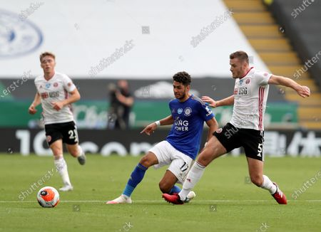 Leicester's Ayoze Perez, centre, duels for the ball with Sheffield United's Jack O'Connell during the English Premier League soccer match between Leicester City and Sheffield United at the King Power Stadium, in Leicester, England