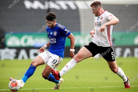 Leichester's Ayoze Perez (L) in action against Sheffield's Jack O'Connell (R) during the English Premier League soccer match between Leicester City and Sheffield United in Leicester, Britain, 16 July 2020.