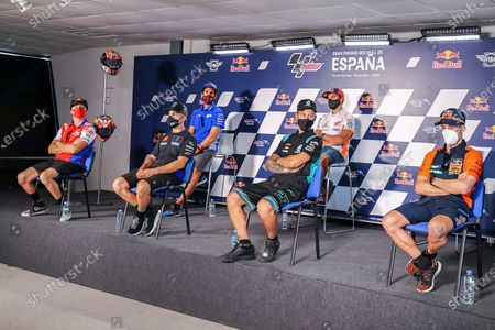 (L-R back) Spanish Moto GP riders Alex Rins, of Suzuki ECSTAR team; and Marc Marquez, of Repsol Honda team; (L-R front) Australian Moto GP rider Jack Miller, of Pramac Racing team; Spanish Moto GP rider Maverick Vinales, of Monster Energy Yamaha MotoGP team; French Moto GP rider Fabio Quartararo, of Petronas Yamaha SRT team; Italian Moto GP rider Valentino Rossi, of Monster Energy Yamaha MotoGP team; and Spanish Moto GP rider Pol Espargaro, of Red Bull KTM Factory Racing, take part in a press conference in Jerez de la Frontera, Cadiz, southern Spain, 16 July 2020. Spain's Red Bull Grand Prix Moto GP Jerez will take place from 17-19 July 2020 at Jerez-Angel Nieto circuit.
