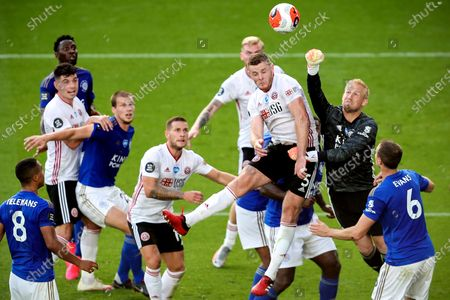 Leichester's goalkeeper Kasper Schmeichel (2-R) in action against Sheffield's Jack O'Connell (3-R) during the English Premier League soccer match between Leicester City and Sheffield United in Leicester, Britain, 16 July 2020.