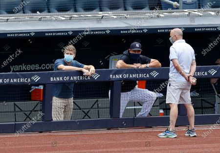 New York Yankees Owner / Managing general partner Hal Steinbrenner (L) New York Yankees manager Aaron Boone (C) and New York Yankees general manager Brian Cashman (R) are seen in the dugout area during summer camp before the start of the 2020 MLB season at Yankee Stadium in the Bronx, New York, USA, 16 July 2020. The start of the season was delayed due to the outbreak of the coronavirus and COVID-19 disease pandemic.