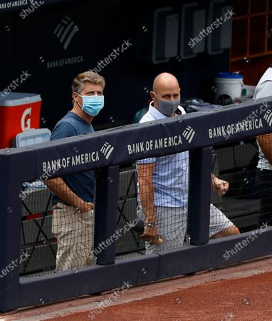 Stock Photo of New York Yankees Owner / Managing general partner Hal Steinbrenner (L) and New York Yankees general manager Brian Cashman are seen in the Yankees dugout during summer camp before the start of the 2020 MLB season at Yankee Stadium in the Bronx, New York, USA, 16 July 2020. The start of the season was delayed due to the outbreak of the coronavirus and COVID-19 disease pandemic.