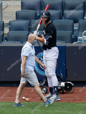 Stock Picture of New York Yankees general manager Brian Cashman  (L) walks past New Yankees outfielder Aaron Judge (R) before he takes batting practice during summer camp before the start of the 2020 MLB season at Yankee Stadium in the Bronx, New York, USA, 16 July 2020. The start of the season was delayed due to the outbreak of the coronavirus and COVID-19 disease pandemic.