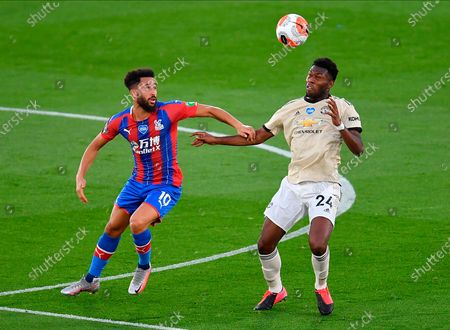 Manchester United's Timothy Fosu-Mensah (R) in action against Crystal Palace's Andros Townsend (L) during the English Premier League match between Crystal Palace and Manchester United in London, Britain, 16 July 2020.