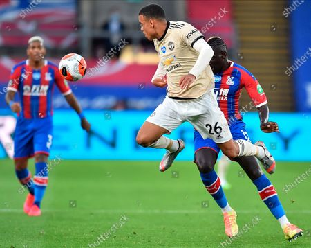 Manchester United's Mason Greenwood (L) in action against Crystal Palace's Mamadou Sakho (R) during the English Premier League match between Crystal Palace and Manchester United in London, Britain, 16 July 2020.
