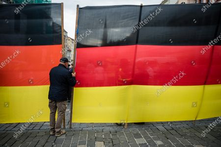 Stock Photo of Supporter attend a rally by the German right-wing party 'Alternative fur Deutschland' ('Alternative for Germany' AfD) in Altenburg, Germany, 16 July 2020. According to media reports, Alternative for Germany party (AfD) faction chairman in the regional parliament of Thuringia Bjoern Hoecke and Alternative for Germany party (AfD) faction chairman in the regional parliament of Brandenburg Andreas Kalbitz, will speak to supporters of the party in the evening.