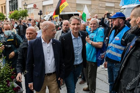 Alternative for Germany party (AfD) faction chairman in the regional parliament of Thuringia Bjoern Hoecke (C) and AfD faction chairman in the regional parliament of Brandenburg Andreas Kalbitz (L) arrive to attend a rally by the German right-wing party 'Alternative fuer Deutschland' in Altenburg, Germany, 16 July 2020.