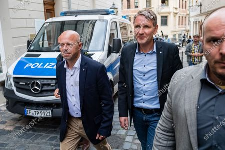 Alternative for Germany party (AfD) faction chairman in the regional parliament of Thuringia Bjoern Hoecke (R) and AfD faction chairman in the regional parliament of Brandenburg Andreas Kalbitz (L) arrive to attend a rally by the German right-wing party 'Alternative fuer Deutschland' in Altenburg, Germany, 16 July 2020.