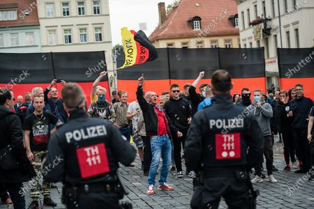 Supporter attend a rally by the German right-wing party 'Alternative fur Deutschland' ('Alternative for Germany' AfD) in Altenburg, Germany, 16 July 2020. According to media reports, Alternative for Germany party (AfD) faction chairman in the regional parliament of Thuringia Bjoern Hoecke and Alternative for Germany party (AfD) faction chairman in the regional parliament of Brandenburg Andreas Kalbitz, will speak to supporters of the party in the evening.
