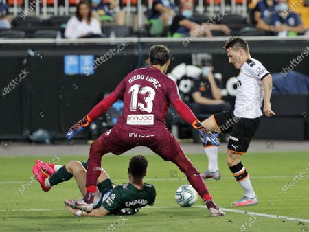 Valencia's Kevin Gameiro (R) in action against Espanyol's Embarba (down) and goalkeeper Diego Lopez (C) during the Spanish LaLiga soccer match between Valencia CF and RCD Espanyol held at Ciutat Mestalla Stadium, in Valencia, Spain, 16 July 2020.