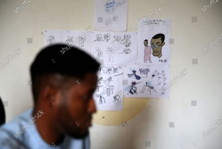 Stock Image of Computer generated drawings are pasted on a wall as Brian Wilson, who has worked as an animator for twelve years, works in his Zero-Gravity animation studio in Lagos, Nigeria, 15 July 2020 (issued 16 July 2020). Like Nigerian popular Nollywood films, the animation is fast gaining popularity among young Nigerian entrepreneurs and creatives.  But the once-obscure animation space in Nigeria is also facing challenges of funding, institutional supports, and lack of training facilities.