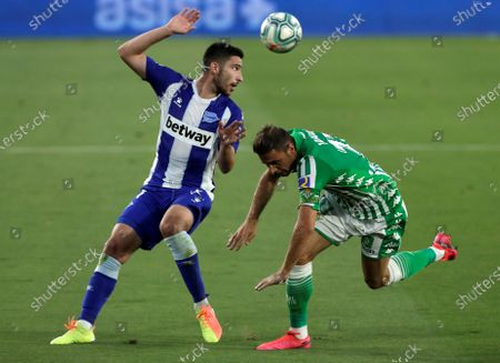 Stock Photo of Real Betis' Joaquin Sanchez (R) in action against Alaves' Alberto Rodriguez (L) during the Spanish LaLiga soccer match between Real Betis and Deportivo Alaves held at Benito Villamarin Stadium, in Sevilla, Spain, 16 july 2020.