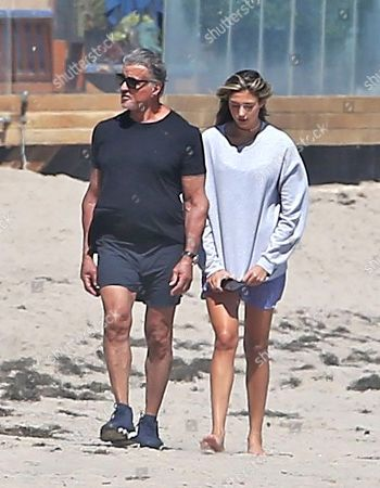 Sylvester Stallone goes for a walk on the beach in Malibu with his daughter, Sophia Rose Stallone