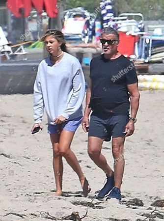 Stock Image of Sylvester Stallone goes for a walk on the beach in Malibu with his daughter, Sophia Rose Stallone