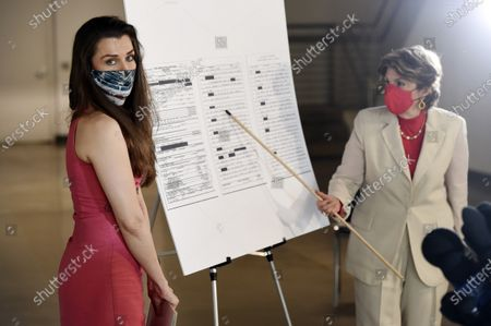 Model Alicia Arden, left, looks on as her attorney Gloria Allred gestures to a blow-up of a 1997 Santa Monica Police Dept. crime report at a news conference at the Allred, Maroko & Goldberg law offices, in Los Angeles. Arden said she was sexually assaulted and battered by the late financier Jeffrey Epstein in 1997 at the Shutters on the Beach hotel in Santa Monica, Calif., but that she was never contacted by police or any prosecutor after filing a police report with the Santa Monica Police Dept