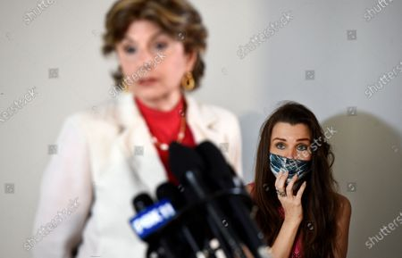 Model Alicia Arden, right, looks on as her attorney Gloria Allred speaks at a news conference at the Allred, Maroko & Goldberg law offices, in Los Angeles. Arden said she was sexually assaulted and battered by the late financier Jeffrey Epstein in 1997 at the Shutters on the Beach hotel in Santa Monica, Calif., but that she was never contacted by police or any prosecutor after filing a police report with the Santa Monica Police Dept
