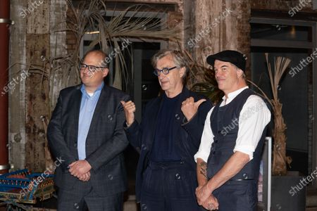 Eric Friedler, Wim Wenders and Andreas Frege attend the premiere of the documentary, 'Wim Wenders, Desperado'