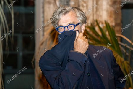 Stock Image of Eric Friedler, Wim Wenders and Andreas Frege attend the premiere of the documentary, 'Wim Wenders, Desperado'