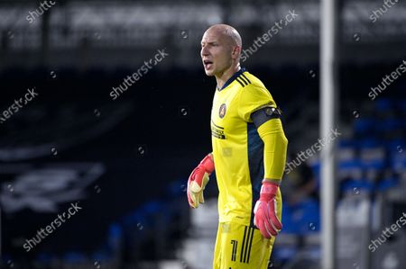 Atlanta United goalkeeper Brad Guzan (1) calls out instructions during an MLS soccer match against the New York Red Bulls, in Kissimmee, Fla