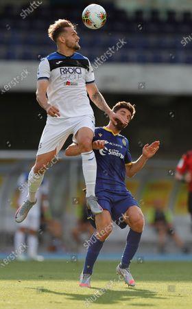 Atalanta's Rafael Toloi climbs above Verona's Fabio Borini.