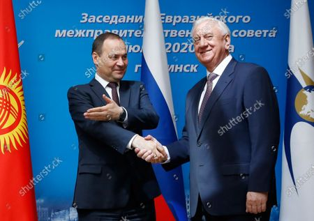 Belarusian Prime Minister Roman Golovchenko (L) shakes hands with Mikhail Myasnikovich, chairman of the Board of the Eurasian Economic Commission (R) prior to the Eurasian Economic Union Intergovernmental Council in Minsk, Belarus, 17 July 2020.