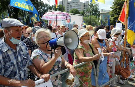 Demonstrators stage the Hands Off Language! Day 2. The Bonfire protest action against draft law N2362 'On Amendments to Certain Legislative Acts of Ukraine on Teaching in the State Language in Academic Institutions' outside the Verkhovna Rada building, Kyiv, capital of Ukraine.