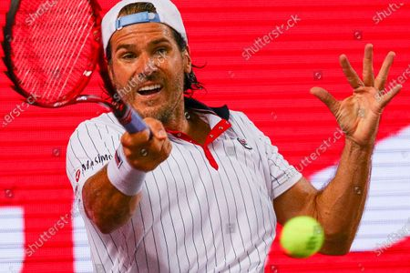 Tommy Haas of Germany in action against Jan-Lennard Struff of Germany during their match of the second stage of the bett1ACES tennis tournament held at hanger 6 of the inactive Tempelhofer feld airport, in Berlin, Germany, 17 July, 2020. The second part of the exhibition tournament will be played on a hard surface, in an airport hanger converted to a small tennis stadium and will be held under strict hygiene restrictions made to cope with the spread of the coronavirus SARS-CoV-2 which causes the COVID-19 disease.