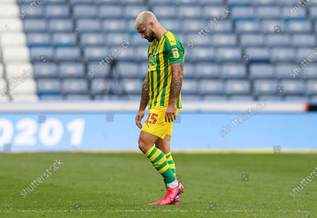 Charlie Austin of West Bromwich Albion trudges off at full time